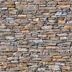Multicoloured wall with irregular stones seamless texture