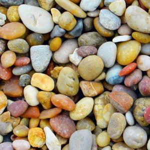 Warm multicoloured round pebbles - close up